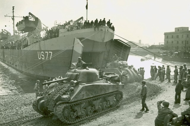 Tanks of an Armored regiment are debarking from an LST [US 77] in Anzio harbor [Italy] and added strength to the U.S. Fifth Army [VI Corps] forces on the beachead (WWII Signal Corps Photograph Collection).