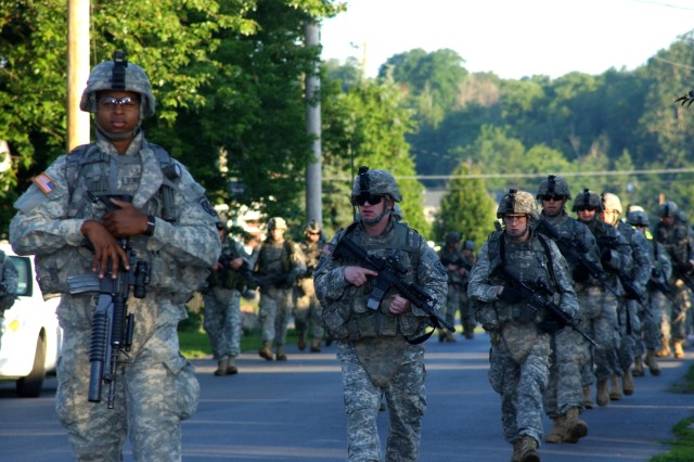 Members of 2nd Battalion, 14th Infantry Regiment, march through the streets of Watertown in the early hours of the morning June 25 during their 25-mile road march.
