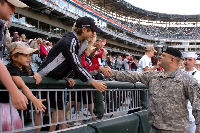 Chicago White Sox fans honor troops for their dedication and service to the nation during pre-game ceremonies at U.S. Cellular Field, Chicago, Ill. July 4.