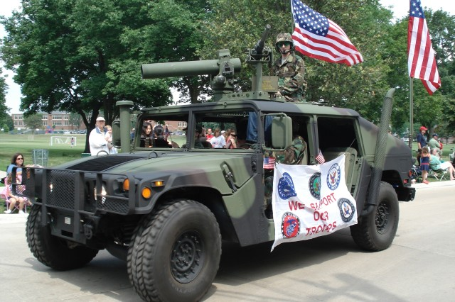 """Members of the Northern Illinois Chapter of the Military Vehicle Preservation Association (NICMVPA), display a """"We Support our Troops"""" flag on their Army Humvee for the Hinsdale 2008 4th of July parade in IL.  The NICMVPA partnered with the USO of Illinois to provide vehicles for the USO volunteers in the parade of about 10,000 attendees."""