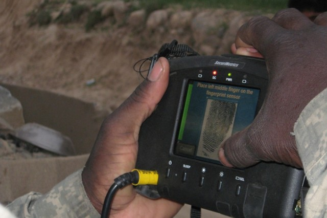 Field reps support Soldiers using devices that determines an individual's identity
