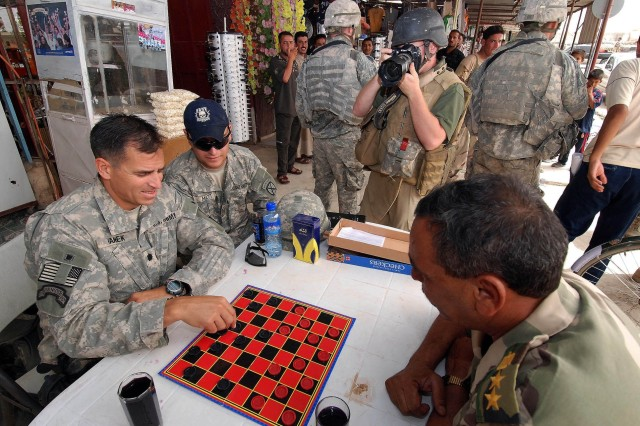 Peaceful board game reflects declining violence in Iraq