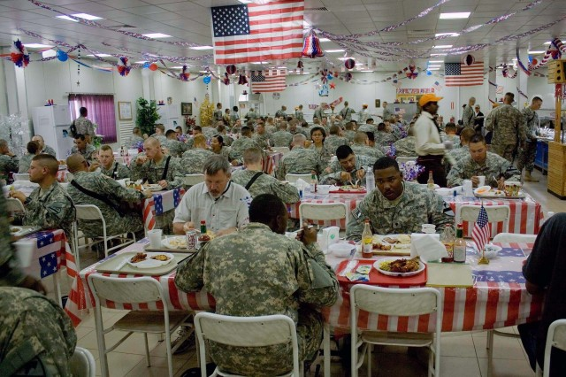 Soldiers assigned to the Long Knife Brigade at Tallil Air Base enjoy dinner in an Independence Day setting at the installation's dining facility July 4. The 4th Brigade Combat Team, 1st Cavalry Division Soldiers mingle with troops from other units and other countries such as Romania at the chow hall everyday.