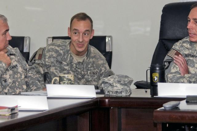 Colonel Philip Battaglia, 4th Brigade Combat Team, 1st Cavalry Division commander, speaks with Gen. David H. Petraeus, Multinational Force-Iraq commander, at COB Adder July 5.