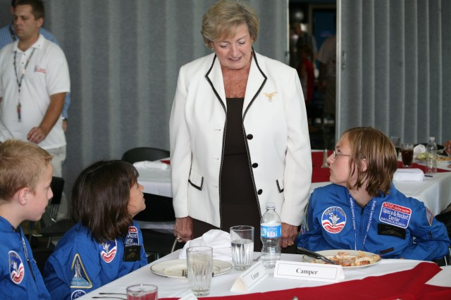 Huntsville's mayor, the Honorable Loretta Spencer, speaks with three of the ASMDA scholarship recipients during their Space Camp Luncheon on July 2. Pictured are Jack Judy of Huntsville, Ala., Kelly Yuson of Omaha, Neb., and Valerie Krepel of Delta Junction, Alaska.