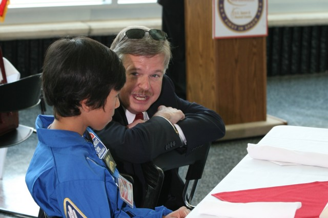 Larry Burger, the director of SMDC/ARSTRAT's Future Warfare Center, talks with Alan Villanueva of Madison, Ala. about his experiences at Space Camp.