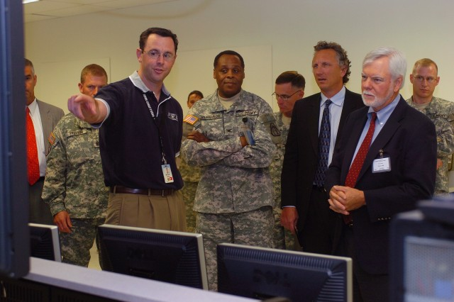 Acting Under Secretary of the Army Nelson Ford tours the System of Systems Integration Lab for Future Combat Systems at the Huntington Beach Campus, Ca., July 8.