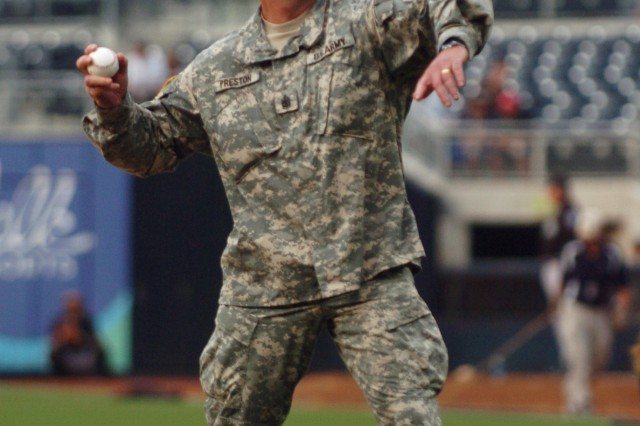 Sgt. Maj. of the Army Kenneth O. Preston throws the ceremonial first pitch of the Padres vs. Marlins game at the Petco Stadium in San Diego, Ca., July 8.