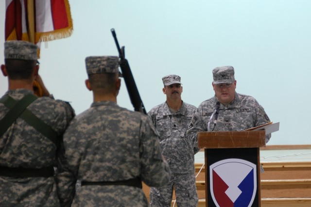 Colonel John F. Wharton, commander, Army Materiel Command - Southwest Asia addresses the audience and units participating in the Transfer of Authority ceremony between the 1108th and 1109th Aviation Classification Repair Activity Depots, July 9, 2008 at Camp Arifjan, Kuwait