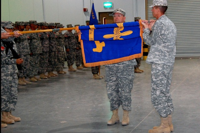 Colonel James G. Young, commander, 1108th Aviation Classification Repair Activity Depot and AVCRAD command sergeant major, Command Sgt. Major Johnny F. Williams, prepare to case the unit colors during a transfer of authority ceremony at Camp Arifjan, Kuwait, July 9, 2008.