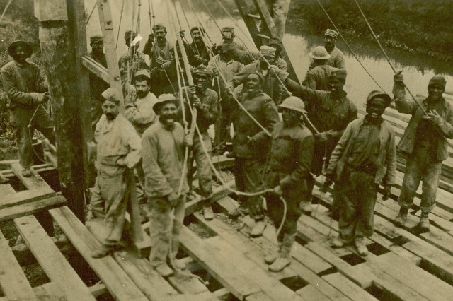 A close-up of the workers on the bridge across the Aire river, which is being built by French and American Engineers. Boureuilles, Meuse, France. Oct. 25th, 1918.