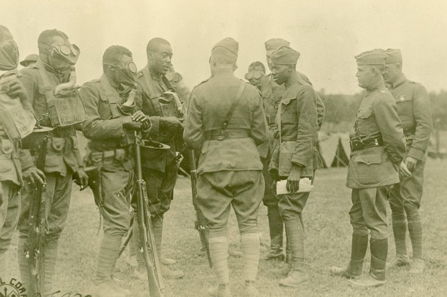 Testing masks, inspection by  gas. 366th  Infantry, 3rd Battalion in France.