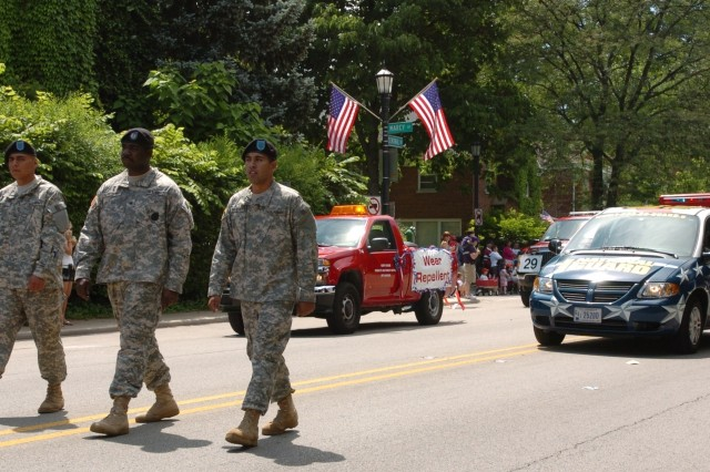 "Pfc. Andres Chavez, Sgt. Ronell Anthony and Pvt. Robert Castillo march down Central Avenue in the 87th annual Evanston 4th of July parade. ""It feels good to see all the support we're getting,"" Chavez said."