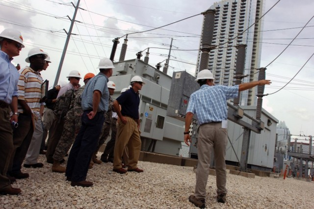 The engineering manager for the Seaholm power substation in Austin, Texas, Dan Smith, discusses what exactly happens in a substation like the one Soldiers from the 2nd Brigade Combat Team, 1st Cavalry Division, were getting a tour of during the city manager's course they attended June 30.