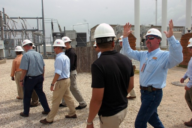 Kevin Brown, superintendent of systems operation at the Seaholm power substation in Austin, Texas, describes many of the components of a substation to Soldiers from the 2nd Brigade Combat Team, 1st Cavalry Division during their trip to the capital for a city manager's course June 30.