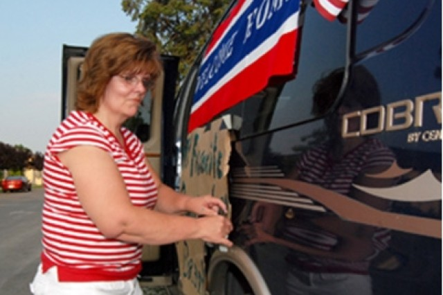 Gail Nelson decorates her family van with flags and a banner welcoming her son-in-law, Spc. Brandon Gruenberg of the 173rd Airborne Brigade Combat Team, home to Vicenza, Italy from deployment in Afghanistan. Gruenberg was one of approximately 250 Soldiers of the 173rd who were among the first brigade troops to return to their home stations in Bamberg, Germany and Vicenza, July 5.