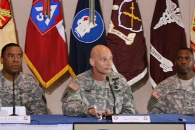 "Col. Jackie Hayes (left), physician, Brooke Army Medical Center; Maj. Gen. Keith Huber (center), U.S. Army South; and Col. Carl Dickens, psychologist, BAMC, address the media July 3 on the health of the freed hostages and the reintegration process. ""They've shown themselves to be strong and adaptive,"" Hayes said."