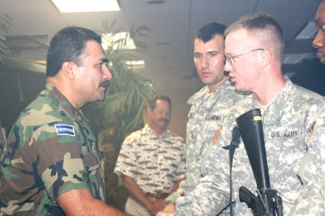 Brig. Gen. Ruben Rubio, chief of staff, army of El Salvador, takes a moment to shake the hand of each medic trainee for their excellent combat medic simulation July 2 at the Department of Combat Medic Training.