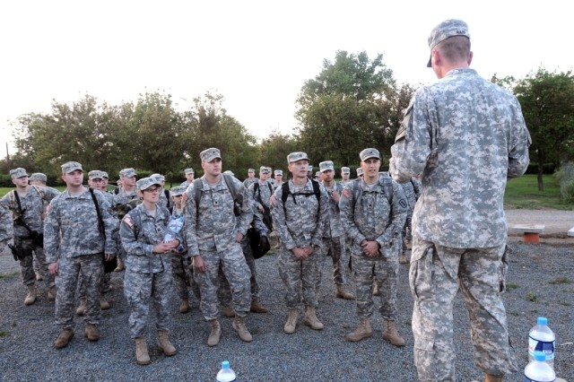 Sgt. 1st Class Samuel Rapp, the JTF-East first sergeant, gives incoming Soldiers an overview of the base facilities at Mihail Kogalniceanu Air Base in Romania.
