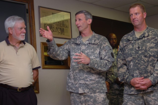 Maj. Gen. Howard B. Bromberg, Fort Bliss commanding general, speaks about the Army Community Covenant commitment while Nelson M. Ford, acting under secretary of the Army and Sgt. Maj. Kenneth O. Preston, Sgt. Maj. of the Army, listen.