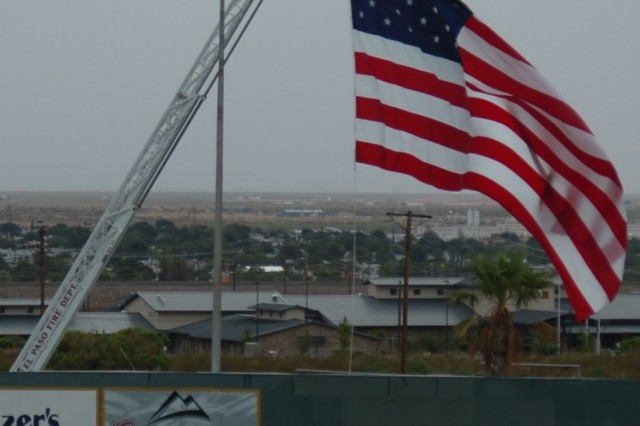 The American Flag is flown from an El Paso Fire Department's ladder truck during the Army Community Covenant signing in El Paso, Texas.