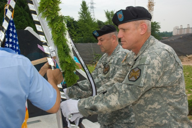 USAG-Yongsan Commander Col. Dave Hall (left) and Command Sgt. Maj. Ralph Rusch lay a wreath at a new Korean War monument in Bupyeong, Incheon Korea July 11.