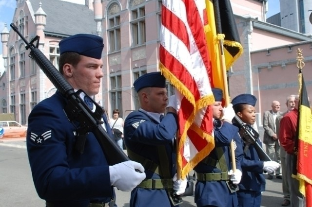 The 309th Airlift Squadron Color Guard composed of  (from left to right) Senior Airman Tyler Gagnon,  Staff Sgt. Jeffrey Krummel, Senior Airman Jesse Marshall and Tech. Sgt. Christine Newton pays tribute to 2nd Lt. John Steinwedel, in a recent ceremony to honor the fallen U.S. Army Air Force pilot who was shot down over Mons, Belgium, and killed by Nazi forces June 5,1944.