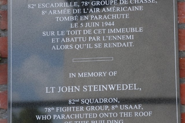 The City of Mons, Belgium recently unveiled A plaque honoring 2nd Lt. John Steinwedel, an American pilot who parachuted from his P-47 D Thunderbolt only to be shot by German forces here June 5, 1944. He will now be remembered by all who walk by No. 6, Rue des Droits de l'Homme in Mons. the plaque is in both French and English.