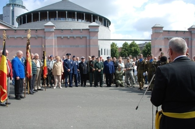 Alderman Jean-Pierre Dupont, representing the City of Mons, recalled the historical events surrounding 2nd Lt. John Steinwedel's death 64 years ago after the unveiling of a plaque to honor the American Pilot murdered after parachuting onto a roof in the city from his P-47 D Thunderbolt during World War II.