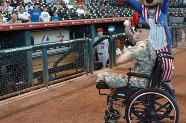 4th ID Double amputee Wounded Soldier throws 1st pitch at Astros game: Staff Sgt. Joseph James, a double amputee formerly 3rd BCT, 4th Inf. Div., warms up for his opportunity to throw the opening pitch for a game between the Houston Astros and L.A. Dodgers.