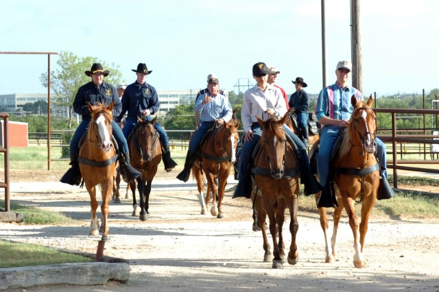"The 1st ""Ironhorse"" Brigade Combat Team leadership enjoyed a horse ride hosted by the Horse Cavalry Detachment June 9.  Members of the group were provided a horse that they took on a trail ride."