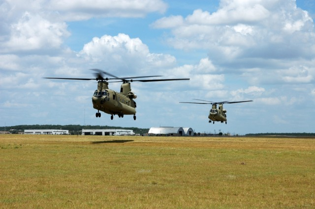 "Two new CH-47F Chinook helicopters from Company B, 2nd Battalion, 227th Aviation Regiment, 1st Air Cavalry ""Warrior"" Brigade, 1st Cavalry Division, hover in a holding pattern before lifting off on a training mission at Fort Hood Army Airfield, Fort Hood, Texas, July 10. One of the most notable differences between the ""F"" model and its predecessor, the ""D"" model, is that it has digital instruments inside its cockpit instead of analog dials and gauges."