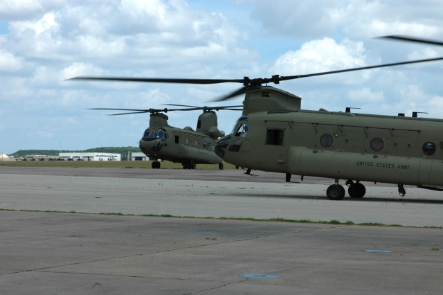 "A new CH-47F Chinook helicopter from Company B, 2nd Battalion, 227th Aviation Regiment,1st Air Cavalry ""Warrior"" Brigade, 1st Cavalry Division, taxis before lifting off on a training mission at Fort Hood Army Airfield, Fort Hood, Texas, July 10. One of the most notable differences between the ""F"" model and its predecessor, the ""D"" model, is that it has digital instruments inside its cockpit instead of analog dials and gauges."