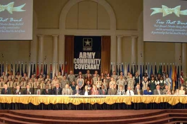 Soldiers, Army Families, Army leaders, community leaders and others gathered at Fort Stewart's Main Post Chapel to sign the Community Covenant Friday.  The covenant is the formal recognition by the Army and communities throughout the nation of the enduring support communities provide to Soldiers and Army Families.  It is intended to continue to foster the strong partnership between the Army and communities to improve the quality of life for Soldiers and their Families.
