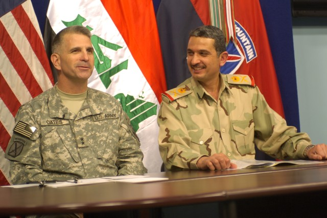 Maj. Gen. Michael Oates, commanding general of Multi-National Division - Center, and Maj. Gen. Ali Salih Farhood Oothman, 8th Iraqi Army Division commander, answer questions during a Pentagon press conference on Camp Victory July 10.