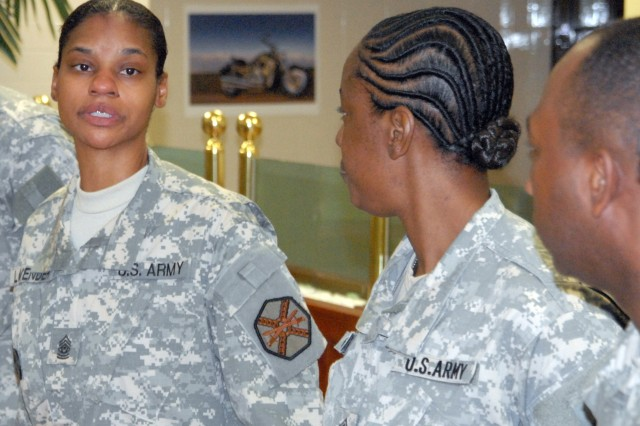 Command Sgt. Maj. Earlene Lavender (left) meets with Soldiers from HHC, USAG-Red Cloud, at Kilbourne Dining Facility following a company visit shortly after taking over as the command's senior Non-commissioned Officer.
