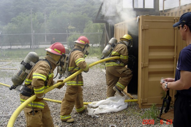 USAG-RC firefighters extinguish a fire during Live Fire Practical Training held on USAG-Casey's training grounds June 30.