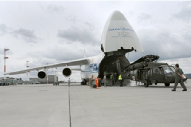 U.S. Soldiers help load a UH-60A Black Hawk helicopter into an Antanov An-124 Ruslan (Condor) aircraft at Ramstein Air Base, Germany July 6 for transport to the Republic of Georgia for Immediate Response 08, a training exercise with participants from U.S., Armenian, and Georgian forces.