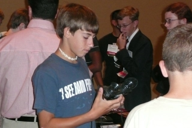 Student Jordan Rosenthal looks at night vision goggles at the U.S. Army Research, Development and Engineering Command's presentation during the 2008 Technology Student Association Conference.