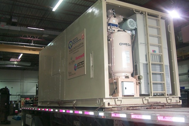 A Mobile Parts Hospital module which was reset by the TACOM Life Cycle Management Command is loaded on a truck June 30 at Ultra Tech Machinery Inc., Cuyahoga Falls, Ohio, to begin its journey to Iraq.