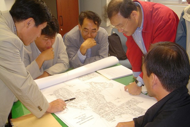 Korean historians review Yongsan Garrison maps during a September 2005 research survey for the Korean Cultural Heritage Administration. Koreans are interested in preserving historical buildings on Yongsan Garrison.