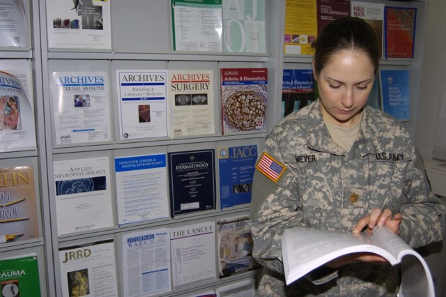 Maj. Stephanie Meyer researches a journal in the library at Landstuhl Regional Medical Center in support of her job as a dietitian. The LRMC medical library is winner of the 2007 Federal Library/Information Center of the Year award in the small library/information center category.