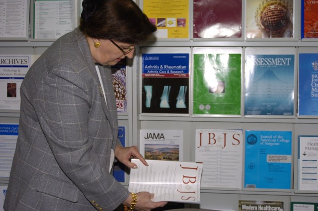 Librarian Cornelia Camerer files away a magazine at Landstuhl Regional Medical Center where her medical library was named winner of the 2007 Federal Library/Information Center of the Year award in the small library/information center category.