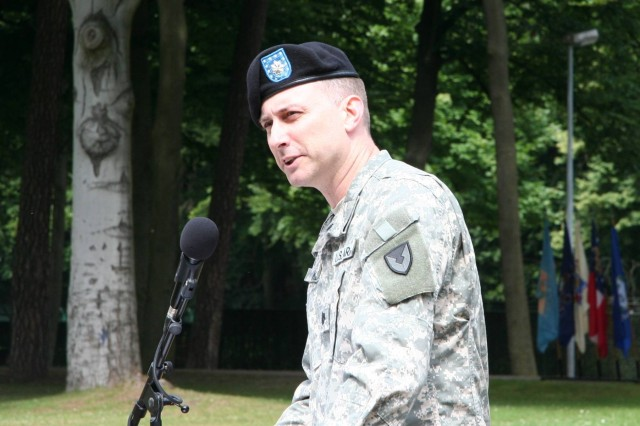 Lt. Col. James Kennedy, the new commander of the 1/405th Army Field Support Brigade, addresses the audience after the ceremony, expressing his delight in returning to Germany and his excitement about being the battalion's new commander.