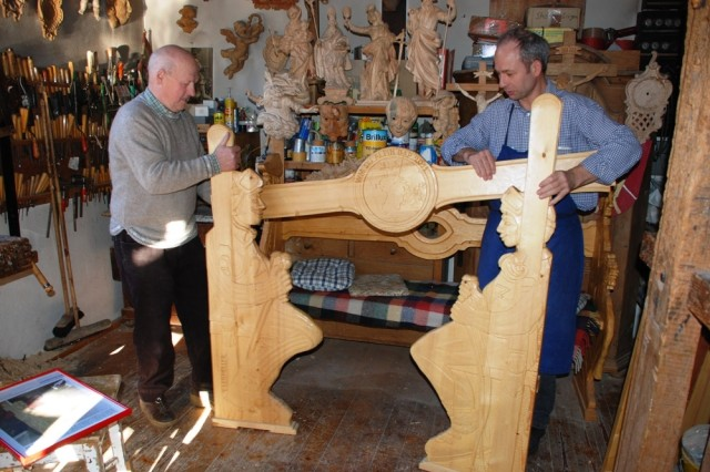 Josef LeismAfA1/4ller and his son Thomas assemble a handcrafted bench in their workshop, one of the larger items they produce in Partenkirchen, Germany.