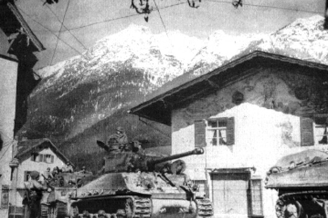 "The 10th Armored ""Tiger"" Division rolling through what is now the pedestrian zone of downtown Garmisch, Germany."