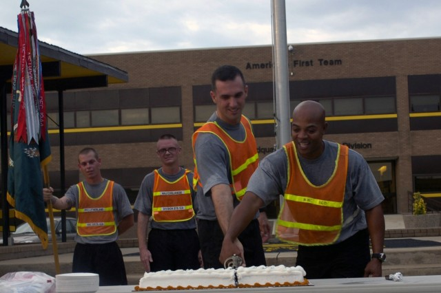Chapel Hill, N.C. native, 1DSTB Commander, Lt. Col. Matthew Karres (left) and New Orleans, La. native Command Sgt. Maj. Clinton Lee Joseph Jr. make the first cut to the Division Special Troops Battalion, 1st Cavalry Division's birthday cake during a ceremony following the battalion's three year anniversary celebration and battalion run July, 15 at Ft. Hood, Texas