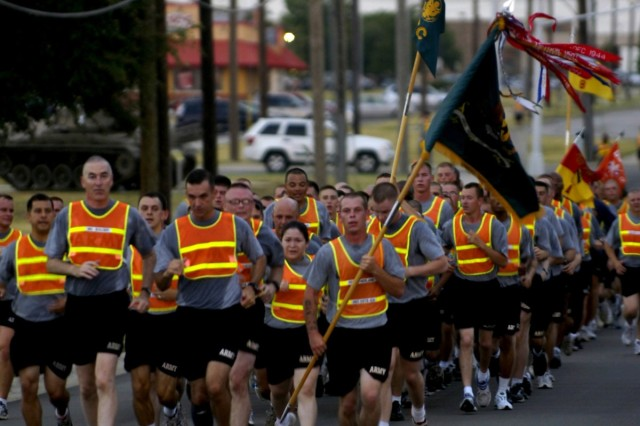 Soldiers from the Division Special Troops Battalion, 1st Cavalry Division, celebrate the Battalion's third anniversary during a battalion run July 15 at Ft. Hood, Texas led by Chapel Hill N.C. native, DSTB Commander, Lt. Col. Matthew Karres, and, Aurora, Ill. native, Maj. Gen. Daniel P. Bolger (left) commanding general, 1st Cav. Div.