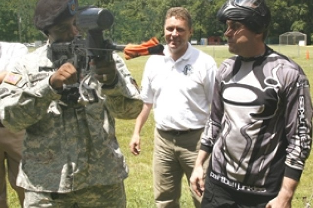 Louis Piccirillo (right) explains a paintball marker to Sgt. Andre L. Gambrell as Hans Karlsen looks on.