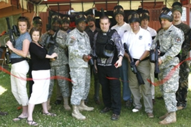 A group of Picatinny employees pose with paintball gear during the facility's ribbon-cutting ceremony.